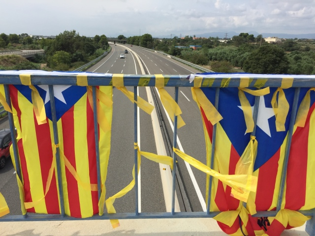 Pro independence flags on brodge over AP7 road